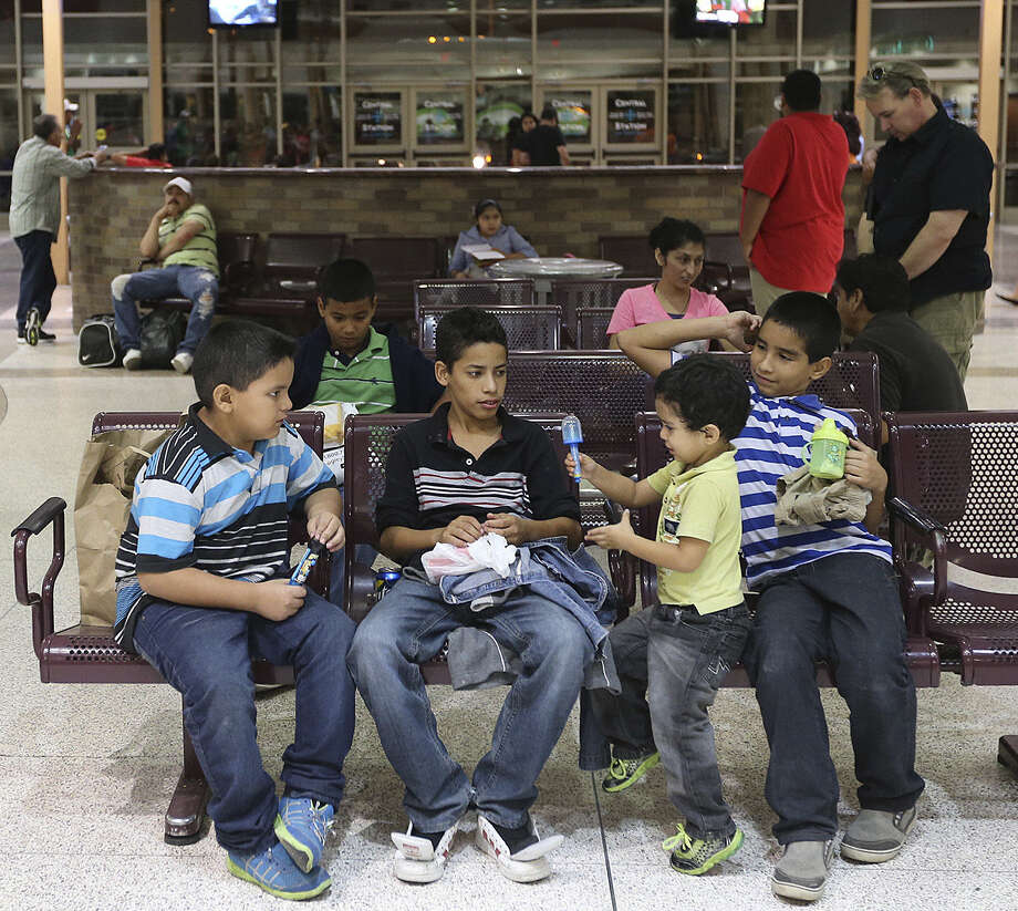 Immigrant minors from Central America wait at a McAllen bus terminal after being released from detention centers last month. Photo: Photos By Jerry Lara / San Antonio Express-News / ©2014 San Antonio Express-News