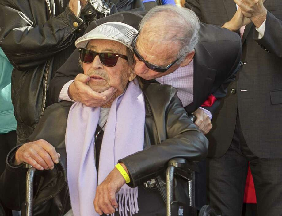 Director-writer Paul Mazursky (left) is kissed by actor Mel Brooks as Mazursky is honored in December with a star on the Hollywood Walk of Fame. Photo: Damian Dovarganes / Associated Press / AP