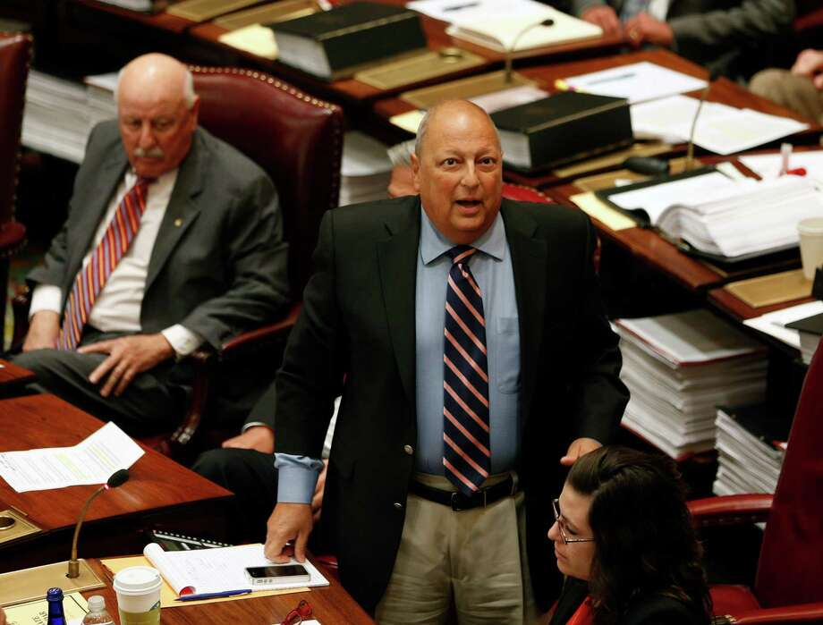 FILE - In this Friday, June 20, 2014 file photo, Sen. Thomas Libous, R-Binghamton, debates medical marijuana legislation in the Senate Chamber at the Capitol in Albany, N.Y. In an indictment unsealed Tuesday, July 1, 2014, the top-ranking New York state senator has pleaded not guilty to a charge that he lied to the FBI about arranging a law firm job for his son. (AP Photo/Mike Groll) ORG XMIT: NY132 Photo: Mike Groll / AP