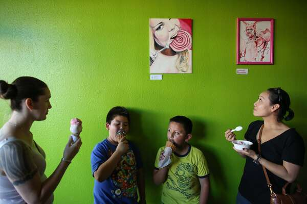 Customers seeking shelter from the 90-plus-degree heat cool off at Full Tilt Ice Cream in White Center.