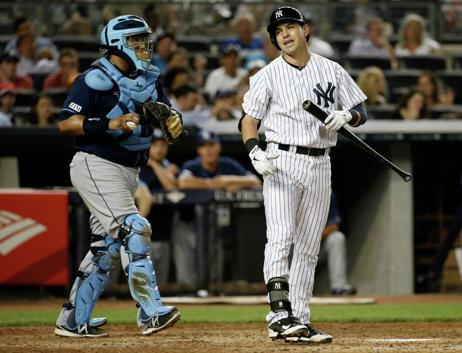 Tampa Bay Rays catcher Jose Molina prepares to throw the ball back to the pitcher as New York Yankees Jacoby Ellsbury, right, reacts after he was called out on strikes in the sixth-inning of a baseball game at Yankee Stadium in New York, Tuesday, July 1, 2014.  (AP Photo/Kathy Willens) ORG XMIT: NYY110 Photo: Kathy Willens / AP