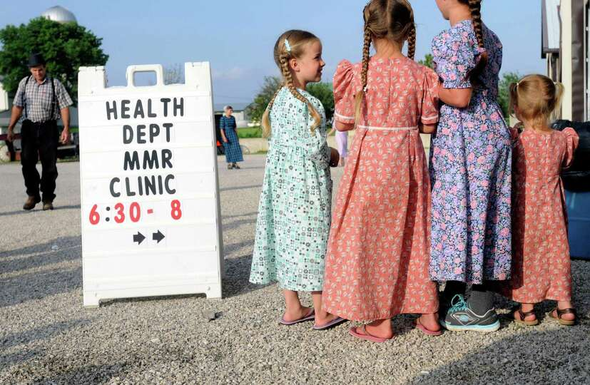 In this June 25, 2014 photo, young Mennonite girls gather at the health and safety clinic, which inc