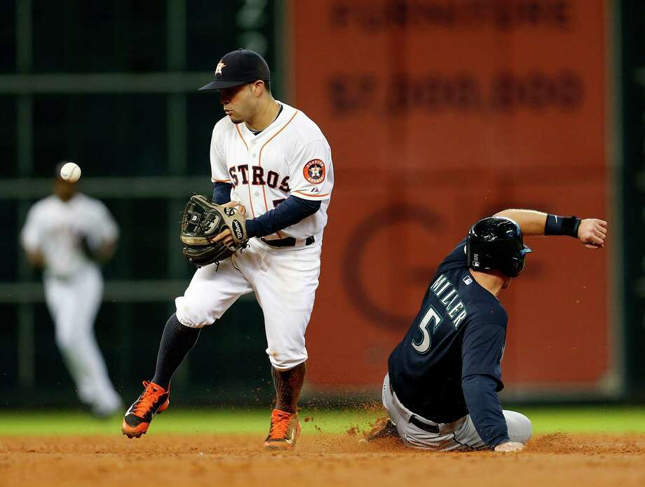 Astros second baseman Jose Altuve loses his grip after forcing the Mariners' Brad Miller in the second. Photo: Karen Warren, Staff / © 2014 Houston Chronicle