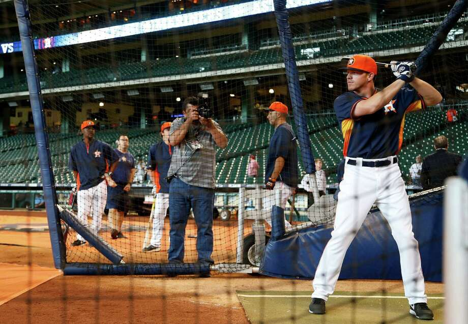 Newly signed outfielder Derek Fisher, who was selected in the Competitive Balance Round A with the 37th overall pick in the draft takes his turn in the batting cage during batting practice before the start of an MLB game at Minute Maid Park, Tuesday, July 1, 2014, in Houston. Photo: Karen Warren, Houston Chronicle / © 2014 Houston Chronicle