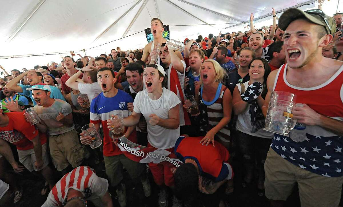 Fans react during a viewing in a tent across from Wolff's Biergarten of the World Cup soccer match with the US against Belgium on Tuesday, July 1, 2014 in Albany, N.Y. (Lori Van Buren / Times Union)