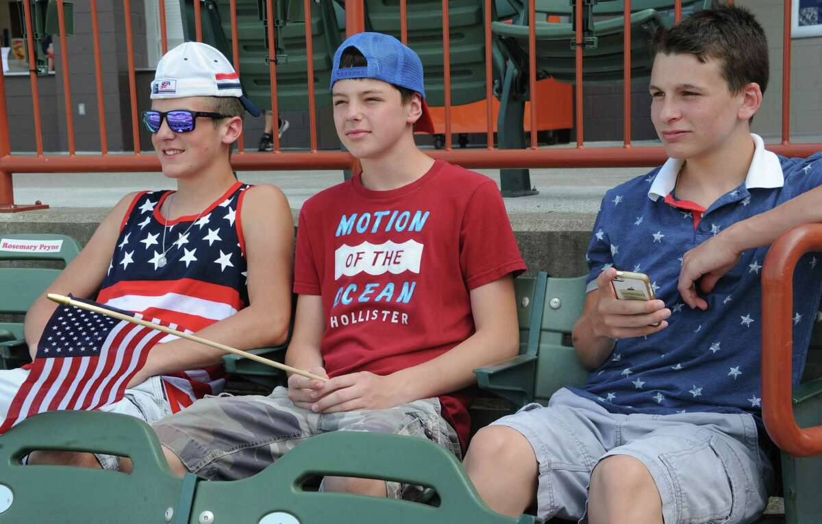 From left, Troy soccer fans Steven Rossman, 15, Jake Bertrand, 14, and James Driscoll, 15, get ready to watch the United States soccer match against Belgium as the Tri-City ValleyCats host a World Cup viewing party at the Joe Bruno Stadium Tueday, July 1, 2014 in Troy, N.Y. (Lori Van Buren / Times Union)