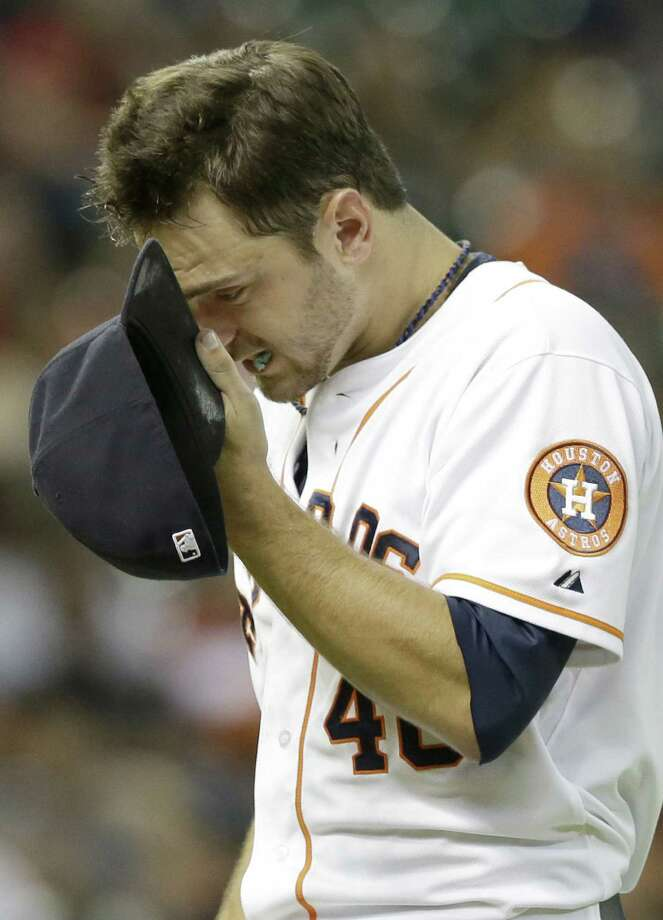 Houston pitcher Jarred Cosart heads to the dugout after being relieved at Minute Maid Park. Photo: Associated Press / AP