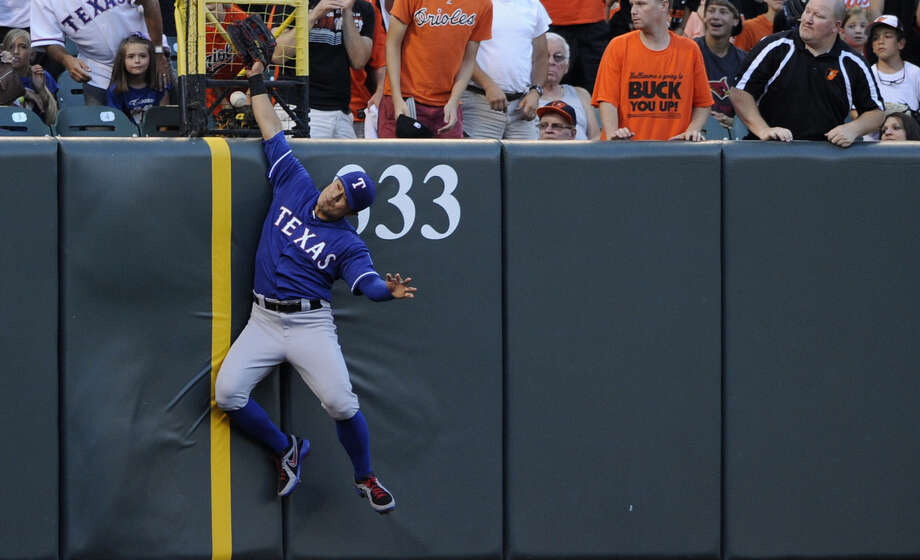 Rangers left fielder Shin-Soo Choo has the ball bounce off his glove for a first-inning home run by the Orioles' Steve Pearce during Texas' seventh consecutive loss on the road. Photo: Nick Wass / Associated Press / FR67404 AP