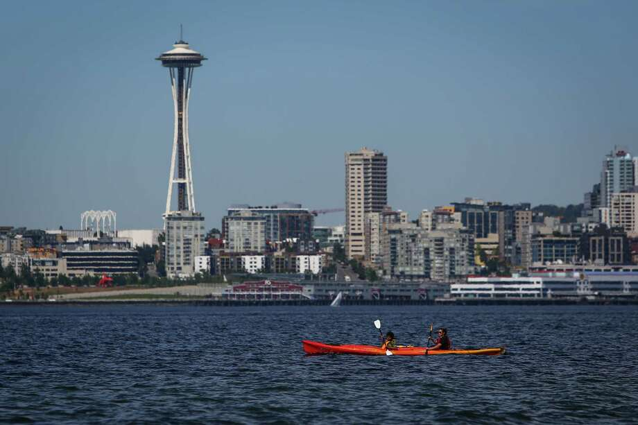 People kayak at Alki Beach. Photo: JOSHUA TRUJILLO, SEATTLEPI.COM / SEATTLEPI.COM