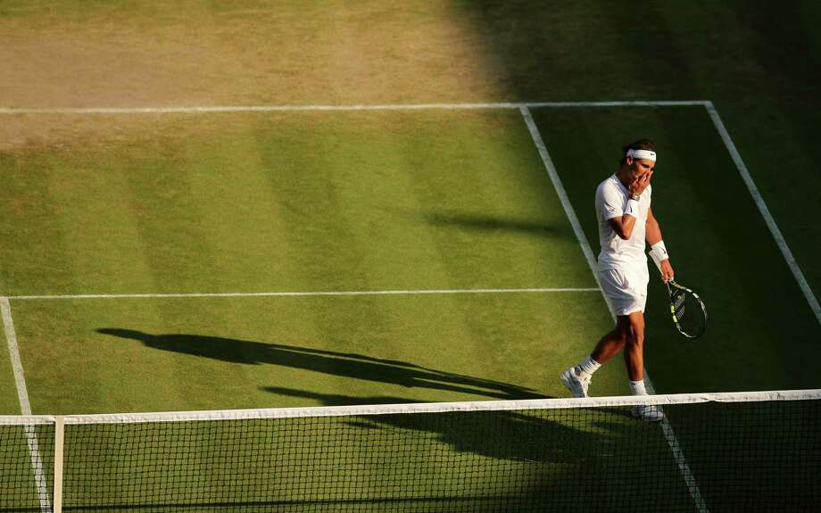 Rafael Nadal, who hasn't won Wimbledon since 2010, walks off Centre Court during his fourth-round loss to Nick Kyrgios. Photo: Andrew Yates / AFP / Getty Images / AFP
