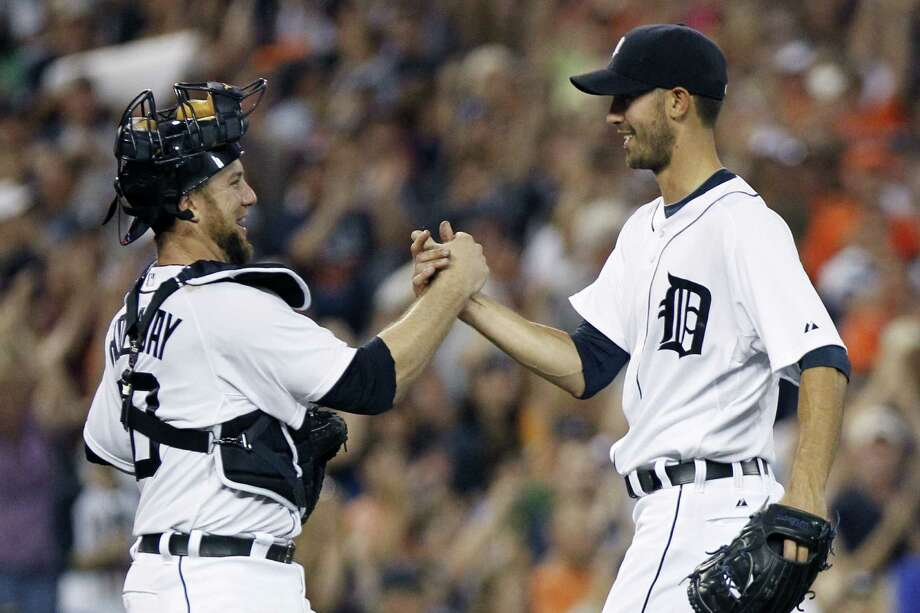 Rick Porcello (right) celebrates with  catcher Bryan Holaday after pitching his second straight shutout. Photo: Duane Burleson / Associated Press / FR38952 AP