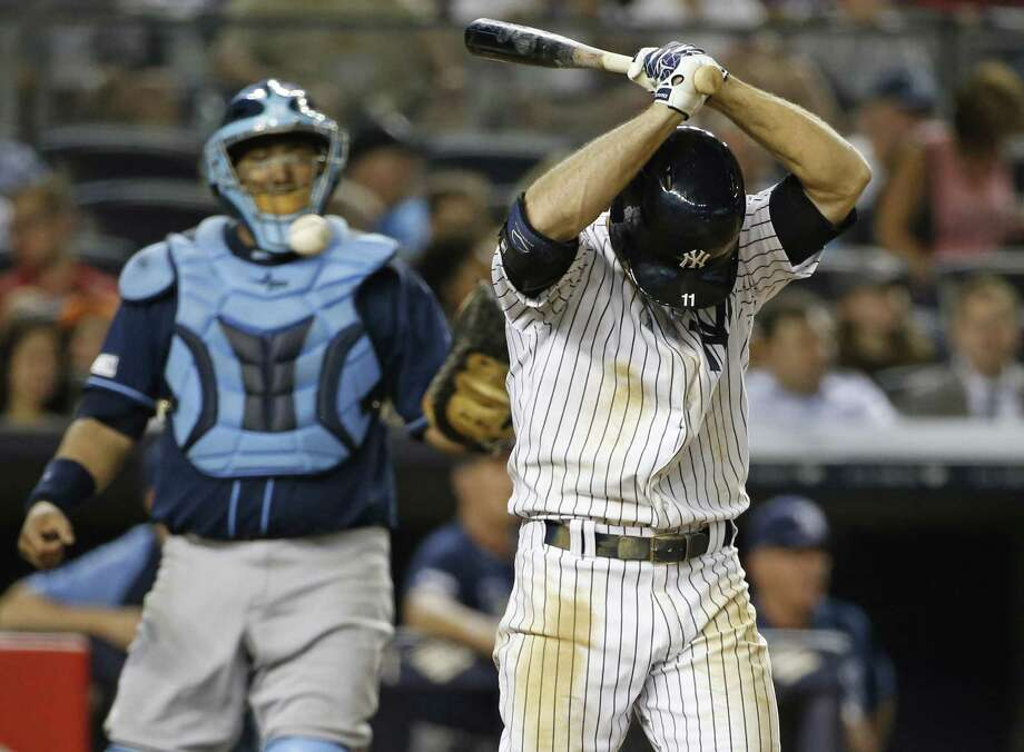 The Yankees' Brett Gardener shows his frustration after striking out Tuesday night. Rays pitcher David Price fanned nine in seven innings. Photo: Kathy Willens / Associated Press / AP