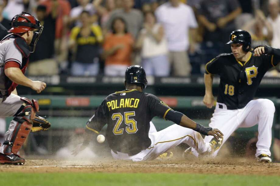 Pittsburgh's Gregory Polanco scores behind Neil Walker (right) on a game-tying double in the ninth. Photo: Keith Srakocic / Associated Press / AP