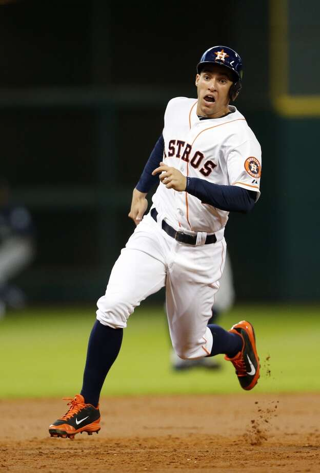 Astros right fielder George Springer (4) charges toward third base on a Matt Dominguez single. Photo: Karen Warren, Houston Chronicle