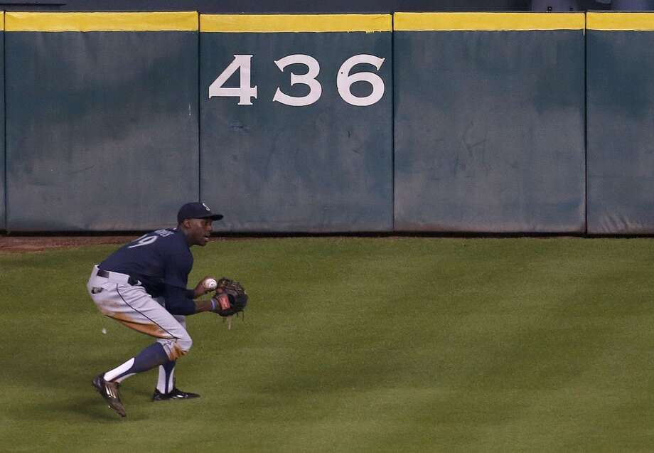 Mariners center fielder James Jones (99) catches George Springer's fly out. Photo: Karen Warren, Houston Chronicle