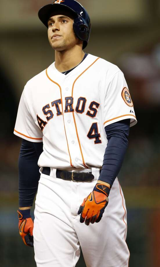 Astros right fielder George Springer (4) reacts after flying out to Mariners center fielder James Jones. Photo: Karen Warren, Houston Chronicle