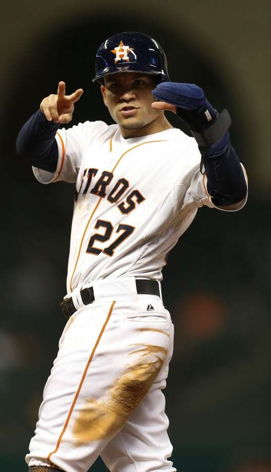 Astros second baseman Jose Altuve (27) stands on first wearing his mitten. Photo: Karen Warren, Houston Chronicle