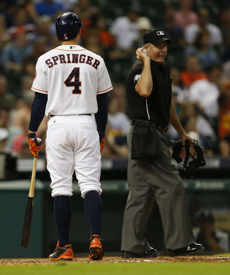 Astros right fielder George Springer (4) reacts after striking out to end the fifth inning. Photo: Karen Warren, Houston Chronicle