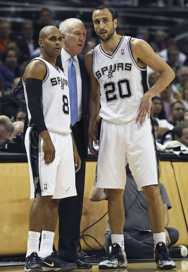 Greg Popovich instructs Patty Mills and Manu Ginobili during a free throw  as the San Antonio Spurs play the Oklahoma City Thunder in game 2 of the Western Conference Finals at the AT&T Center on May 21, 2014. Photo: TOM REEL