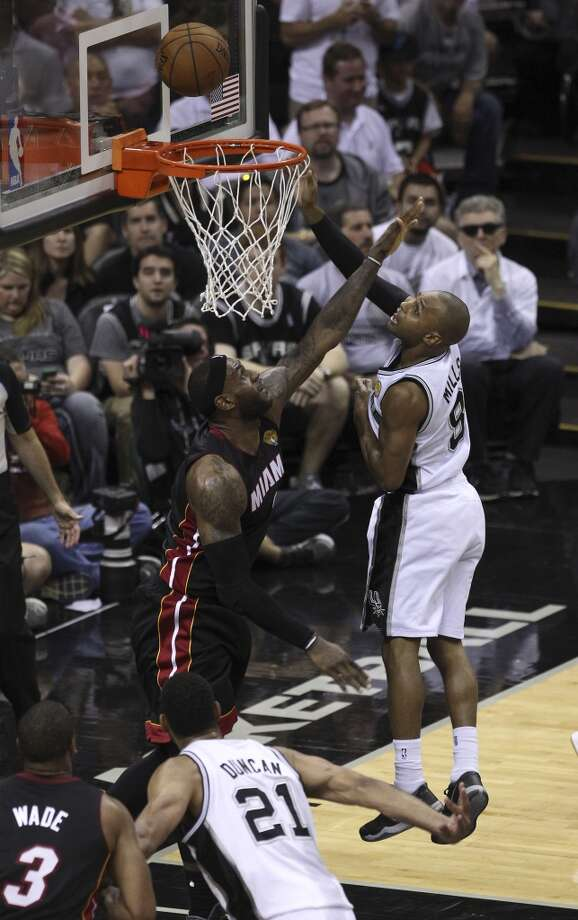 San Antonio Spurs' Patty Mills takes a shot against Miami Heat's LeBron James in Game 5 of the 2014 NBA Finals at the AT&T Center on Sunday, June 15, 2014. (Kin Man Hui/San Antonio Express-News) Photo: Kin Man Hui, San Antonio Express-News