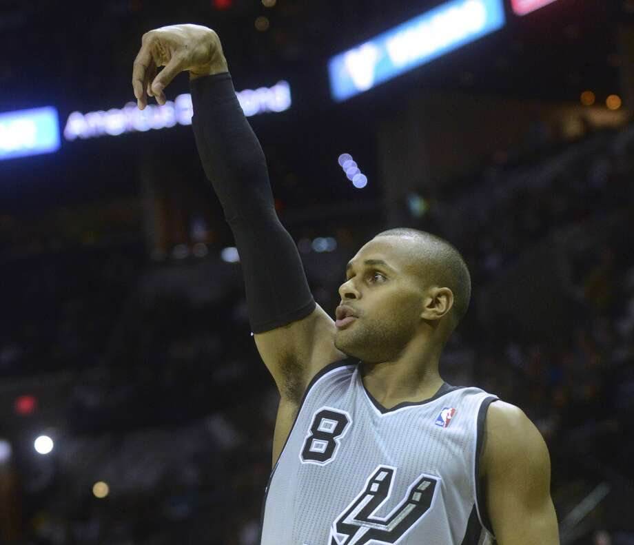San Antonio Spurs guard Patty Mills watches as his three-point shot goes through the net during NBA action in the AT&T Center on Saturday, Nov. 23, 2013. Photo: Billy Calzada, San Antonio Express-News