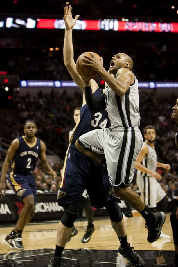 Patty Mills takes a shot against the New Orleans Pelicans in the second half, Saturday March 29, 2014 at the AT&T Center. The Spurs kept a steady lead throughout the entire game and won 96-80. Photo: Julysa Sosa