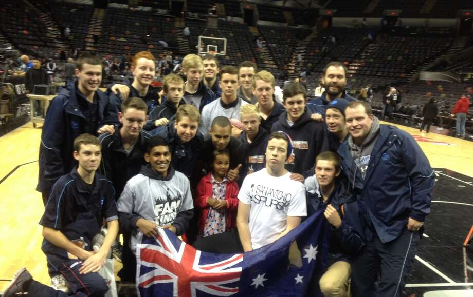 Spurs guard Patty Mills interacts with the team from Marist College Canberra (Australia), his alma mater, at a game at the AT&T Center in January. Photo: Courtesy Photo