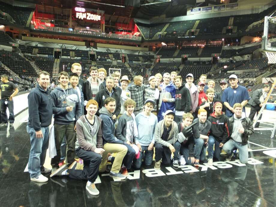 Canberra (Australia) Grammar School's basketball team interacts with Spurs guard Patty Mills at the AT&T Center after a December game. This team toured the United States and played an exhibition against Central Catholic. Photo: Courtesy Photo