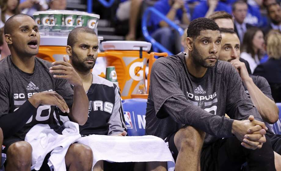 San Antonio Spurs' Patty Mills (from left), Tony Parker, Tim Duncan and Manu Ginobili watch second half action in Game 4 of the Western Conference Finals against the Oklahoma City Thunder Tuesday May 27, 2014 at Chesapeake Energy Arena in Oklahoma City, OK. Photo: Edward A. Ornelas, San Antonio Express-News