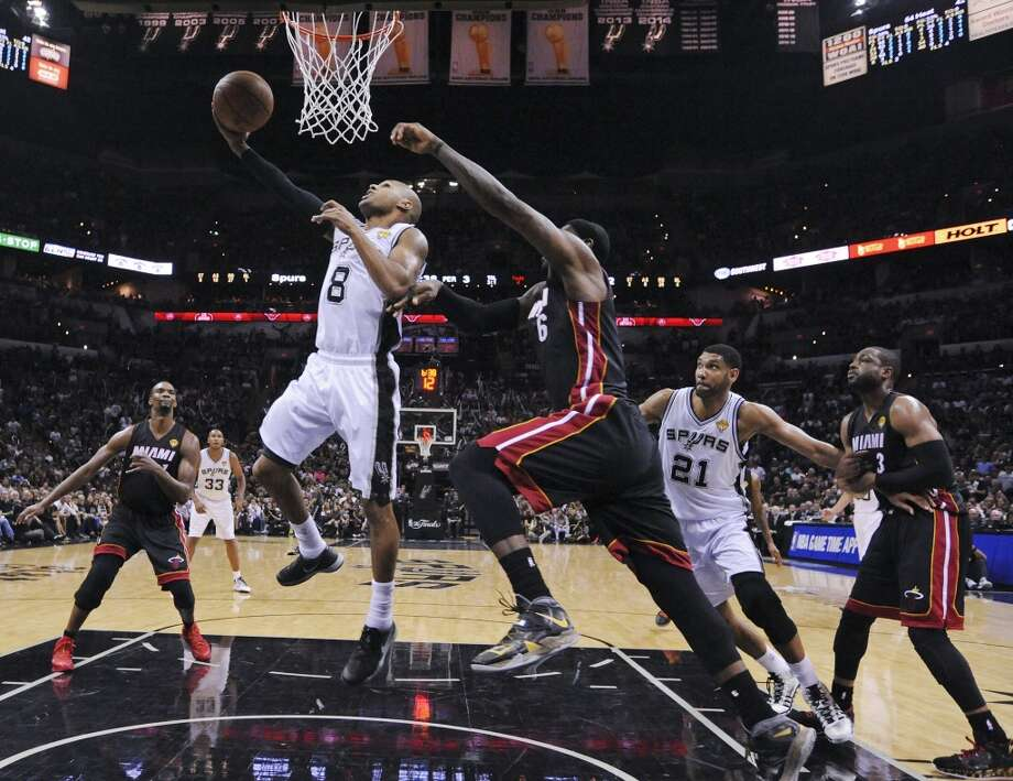San Antonio Spurs' Patty Mills shoots around Miami Heat's LeBron James in Game 5 of the 2014 NBA Finals Sunday June 15, 2014 at the AT&T Center. The Spurs won 104-87. Photo: Edward A. Ornelas, San Antonio Express-News