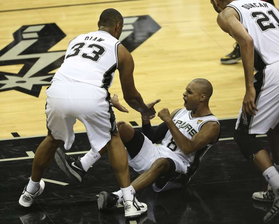 San Antonio Spurs' Patty Mills celebrates after drawing a foul against the Miami Heat during the first quarter of game five of the NBA Finals at the AT&T Center, Sunday, June 15, 2014. Photo: Jerry Lara, San Antonio Express-News
