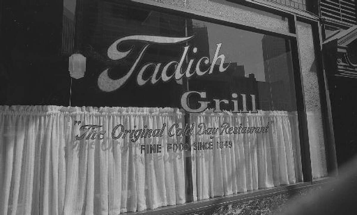 The front window, with the gold leaf lettering and the half curtains were a fixture in the old location, as they are in the current location.
