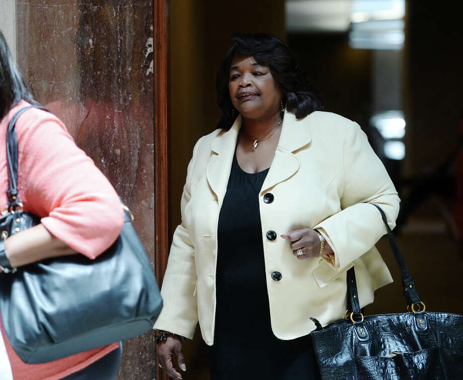 "Patricia Lambert heads into Judge Tom Rugg's courtroom after lunch Tuesday. Ron Reynolds' case against the Beaumont Independent School District continued in state District Judge Tom Rugg's courtroom Tuesday. Reynolds alleges that his inclusion on the district's reduction-in-force list is a matter of retaliation against a ""threat to the central power of the district."" Photo taken Tuesday 7/1/14 Jake Daniels/@JakeD_in_SETX Photo: Jake Daniels / ©2014 The Beaumont Enterprise/Jake Daniels"