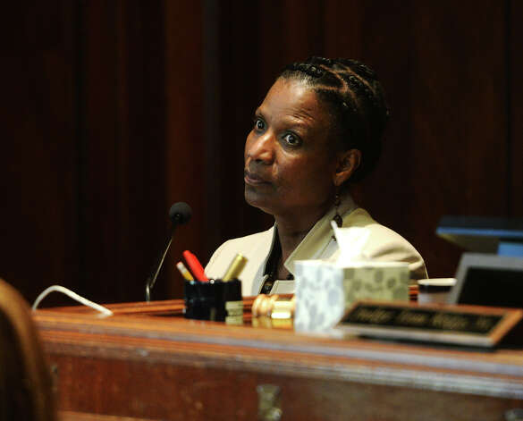"Jessie Haynes looks toward Superintendent Dr. Timothy Chargois' table during Tuesday's proceedings. Ron Reynolds' case against the Beaumont Independent School District continued in state District Judge Tom Rugg's courtroom Tuesday. Reynolds alleges that his inclusion on the district's reduction-in-force list is a matter of retaliation against a ""threat to the central power of the district."" Photo taken Tuesday 7/1/14 Jake Daniels/@JakeD_in_SETX Photo: Jake Daniels / ©2014 The Beaumont Enterprise/Jake Daniels"