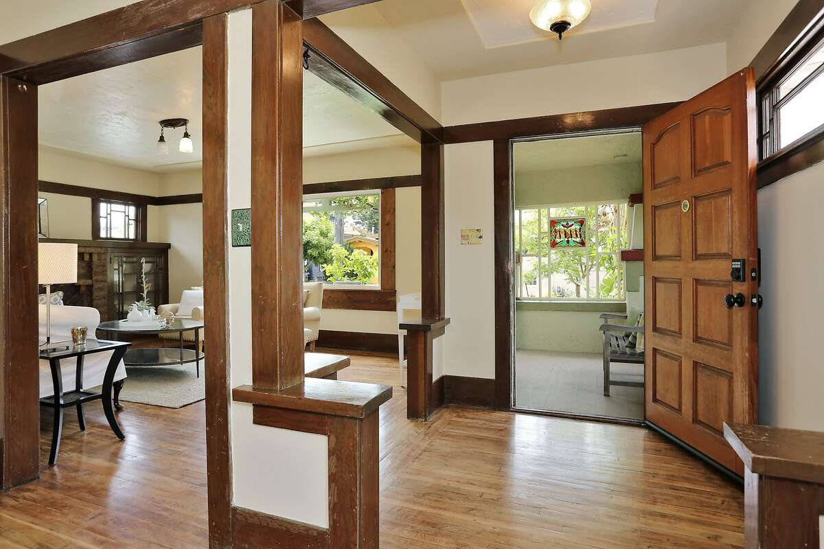 The entry hosts hardwood trim, stained glass and picture windows.