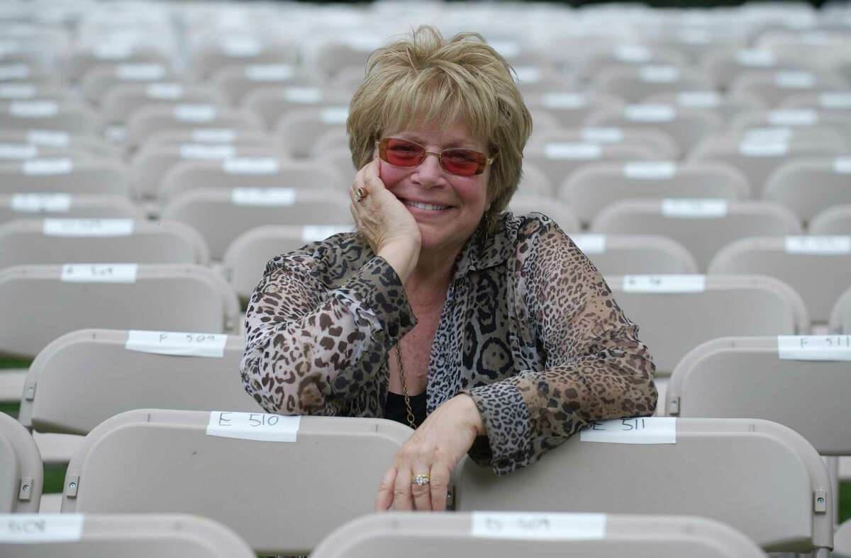 Phyllis Cortese, Executive Director of the Ives Concert Park, sits in the reserve seats, set up for the Peter Frampton concert at the Ives Concert Park, on Tuesday, July 1, 2014. The Ives Concert Park is located on the Westside Campus of Western Connecticut State University, in Danbury, Conn.
