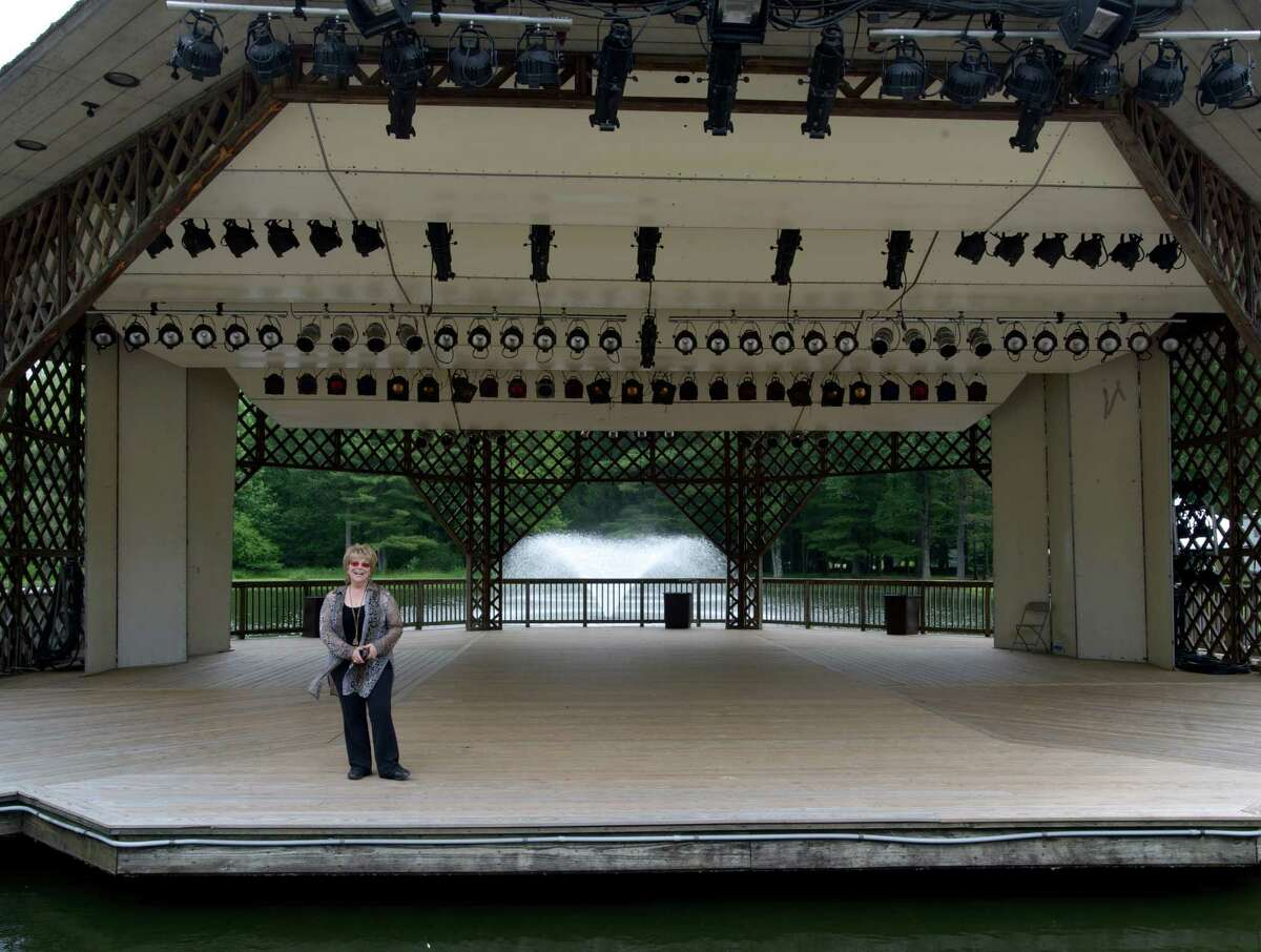 Phyllis Cortese, Executive Director of the Ives Concert Park, stands on the Donald E. Weeden Pavillion at Ives Concert Park, located on the Westside Campus of Western Connecticut State University, in Danbury, Conn. Tuesday, July 1, 2014.