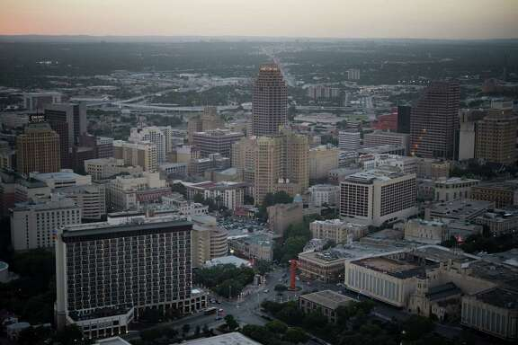 Buildings stand in the skyline of downtown San Antonio. Localities in Texas, home to seven of the nation's 15 fastest-growing cities, are bearing the financial burden as the state gains 1,000 residents a day.