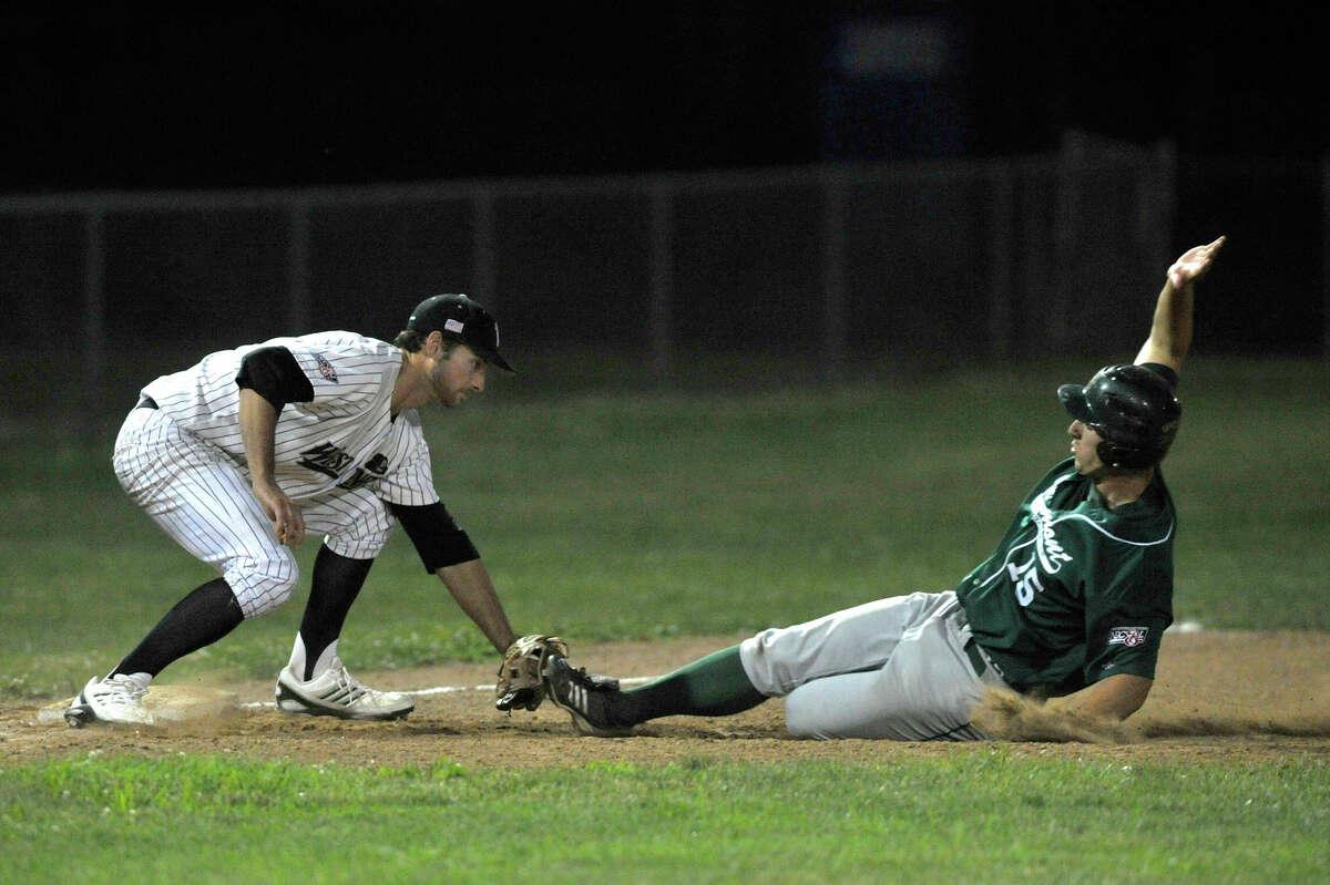 Danbury's Jake Stinnett catches Vermont's Ryan Karl stealing third base during their game Saturday, July 7, 2012. Danbury won, 12-9.