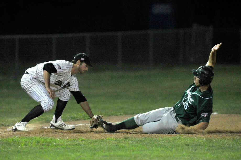 Danbury's Jake Stinnett catches Vermont's Ryan Karl stealing third base during their game Saturday, July 7, 2012. Danbury won, 12-9. Photo: Jason Rearick / The News-Times