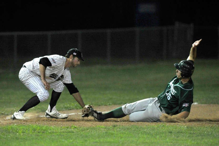 Danbury's Jake Stinnett catches Vermont's Ryan Karl stealing third base during their game Saturday, July 7, 2012. Danbury won, 12-9. Photo: Jason Rearick / The News-Times