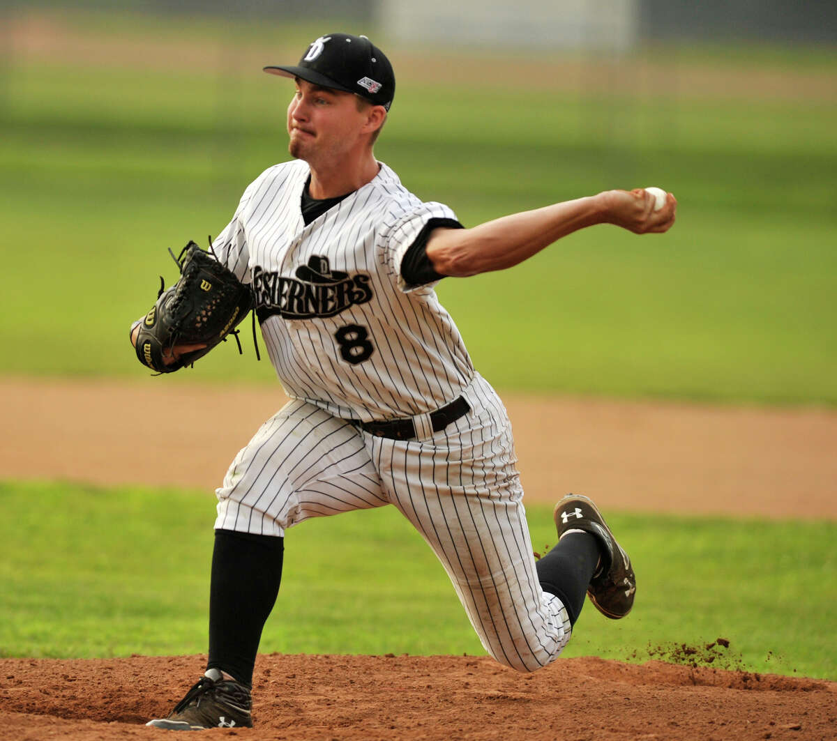 Danbury's Ben Brewster pitches during game 2 of their Western Division playoff game against Keene at Rogers Park in Danbury on Wednesday, Aug. 8, 2012. Danbury won, 12-11, advancing to the finals against the Newport Gulls.