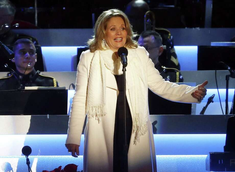Renee Fleming performing at the National Christmas Tree lighting ceremony across from the White House in Washington. (AP Photo/Charles Dharapak, File Photo: Charles Dharapak / AP