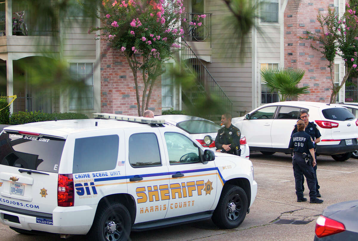 The Harris County Sheriff's Office investigates a scene after a woman was found dead at an apartment complex in the 19300 block of Park Row, Wednesday, July 2, 2014, in Katy.