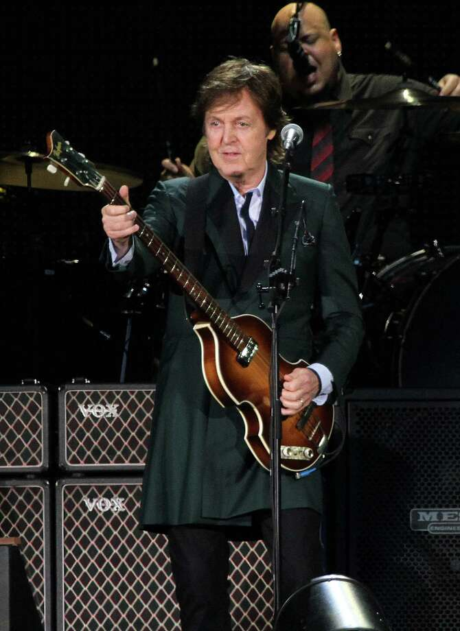File- This July 9, 2013, file photo shows Paul McCartney performing at Fenway Park in Boston. McCartney is rescheduling U.S. tour dates as he continues to recover from a virus he received treatment for last month. The former Beatles singer announced Monday, June 9, 2014, tour stops scheduled for mid-June will be postponed to October. He was supposed to kick off the U.S. leg of his tour Saturday. Instead his first show will be July 5 in Albany, New York. (Photo by Marc Andrew Deley/Invision/AP, File) ORG XMIT: NY116 Photo: Marc Andrew Deley / Invision