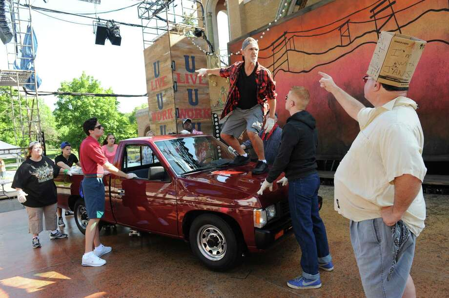 "The cast of ""Hand on a Hardbody,"" about a group of people who stand for days holding onto a pickup truck in order to win the vehicle, rehearse for the Park Playhouse production at the Washington Park Lake-house on Thursday June 26, 2014 in Albany, N.Y. (Michael P. Farrell/Times Union) Photo: Michael P. Farrell / 00027500A"