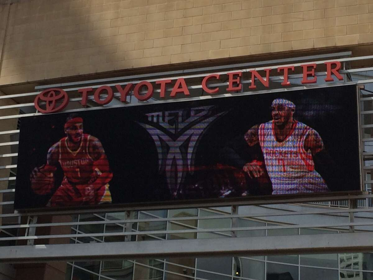 Free-agent Carmelo Anthony is shown in a Rockets uniform on the marquee at Toyota Center on Wednesday.