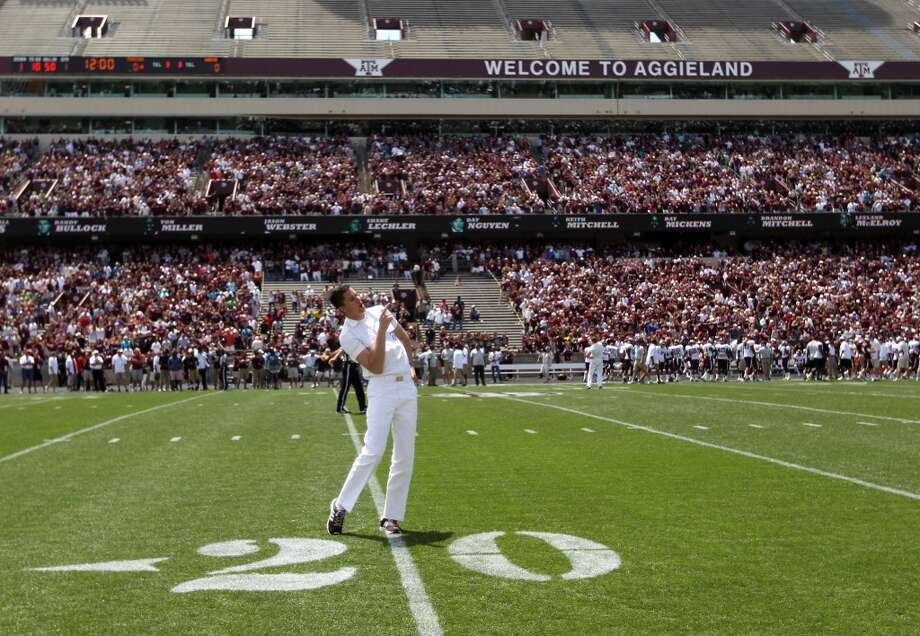 An Aggie Yell Leader leads a cheer on the field at Kyle Field, which will be the largest in the SEC and third-largest nationally after its renovation. Photo: Karen Warren, Chronicle
