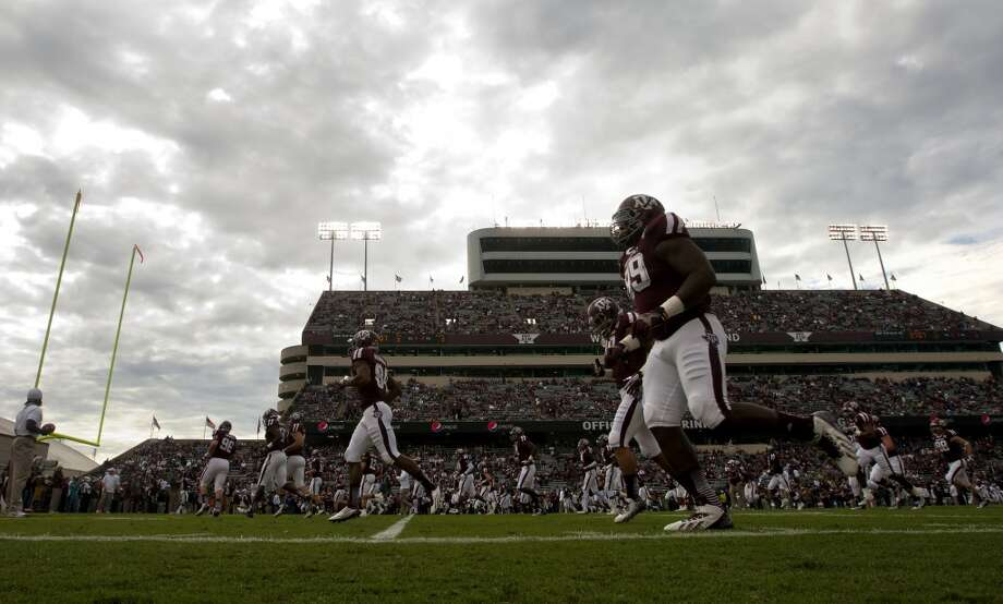 The Aggies warmup before a game on Nov. 9, 2013. Photo: Cody Duty, Houston Chronicle