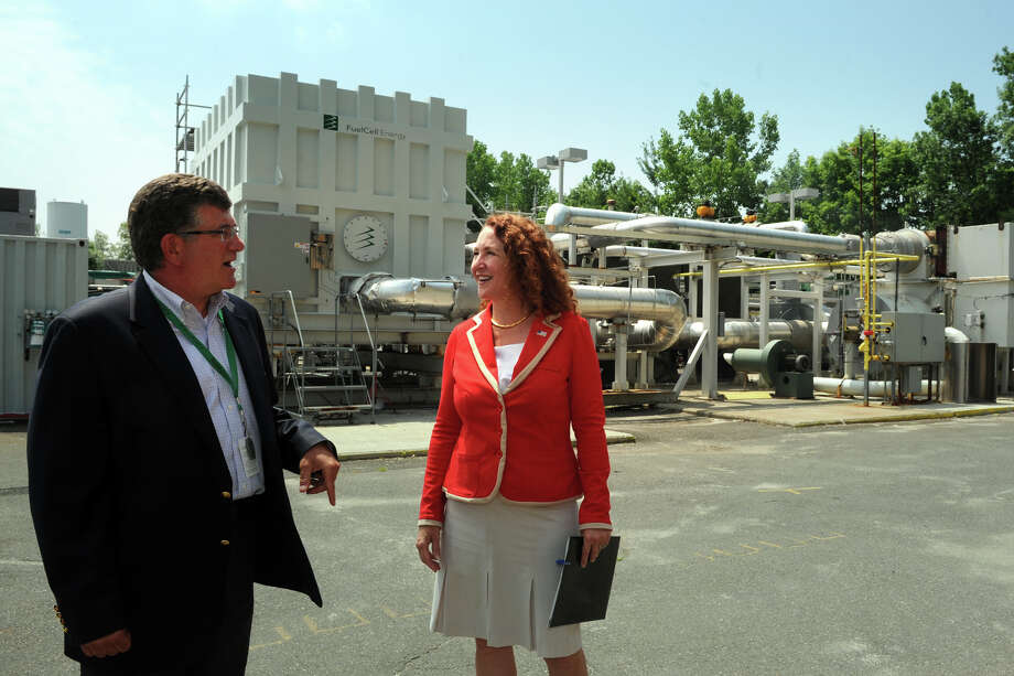 Anthony Rauseo, Senior Vice President and Chief Operating Officer for FuelCell Energy, leads U.S. Rep. Elizabeth Esty on a tour of the companyís facility in Danbury, Conn., July 2, 2014. Photo: Ned Gerard / Connecticut Post